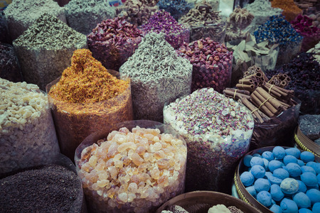 Dried herbs, flowers and arabic spices in the souk at Deira in Dubai, UAE.
