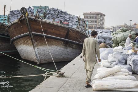 DUBAI, UAE-JANUARY 19: Loading a ship in Port Said on January 19, 2017 in Dubai, UAE. The oldest commercial port of Dubai