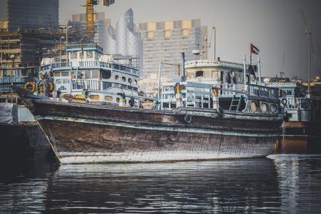 bur dubai: DUBAI, UAE-JANUARY 19: Loading a ship in Port Said on January 19, 2017 in Dubai, UAE. The oldest commercial port of Dubai