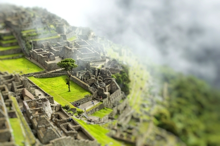View of the ancient Inca City of Machu Picchu. The 15-th century Inca site.Lost city of the Incas. Stock Photo
