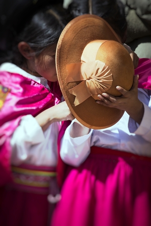 Puno, Peru - Native people from peruvian city dressed in colorful clothing perform traditional dance in a religious celebration. Peru, South America. Stock Photo