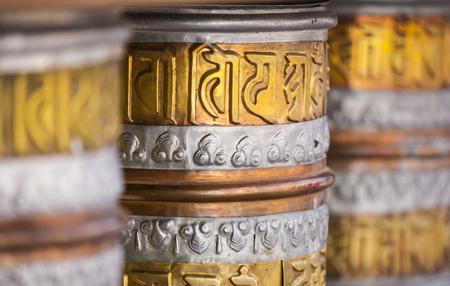 devote: Buddhist prayer wheels in Leh, India.
