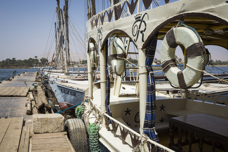 Wooden boats felucca at the Nile River in Aswan, Egypt, North Africa