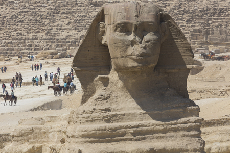 cheops: Closeup view of the Sphinx head with pyramid in Giza near Cairo, Egypt