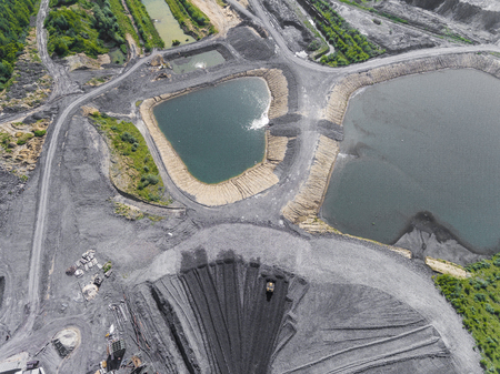 Black coal deposits. Exploration and machine. View from above. Stock Photo