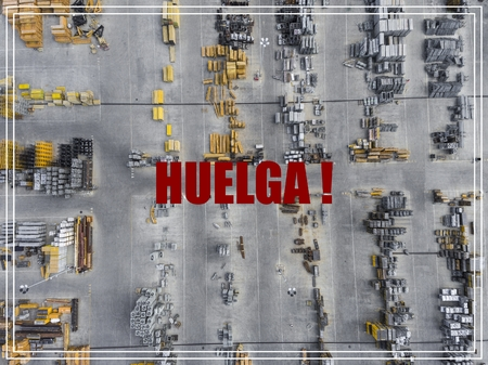 Word Huelga in spanish language. Industrial storage place, view from above.