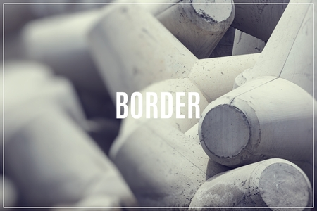 Word Border over breakwater concrete block. Zdjęcie Seryjne