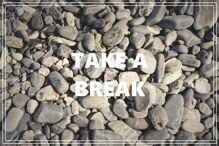 Word Take a Break. Sea stones as background.