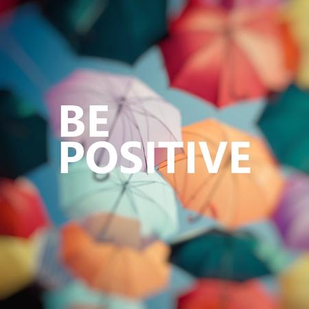 Positive Thinking. Background colorful umbrella.