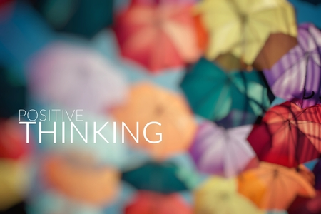 converging: Positive Thinking. Background colorful umbrella.