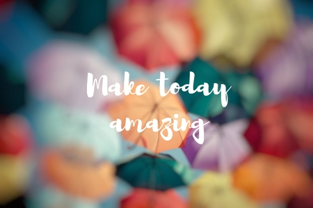 Make today amazing. Background colorful umbrella street decoration. Stock Photo