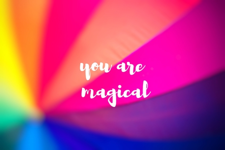 You are magical. Rainbow coloured umbrella. Stock Photo