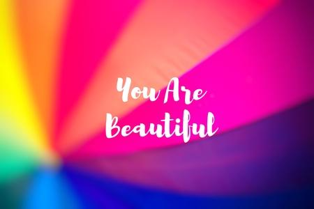 crimson colour: You Are Beautiful. Rainbow coloured umbrella.