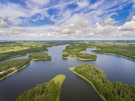 masuria: Aerial view of green islands and clouds at summer sunny day.Wydminy lake on Masuria in Poland. Stock Photo