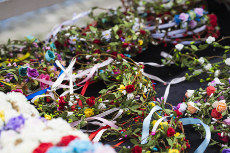 boxing day: Colorful traditional flower wreath on sale on local market.