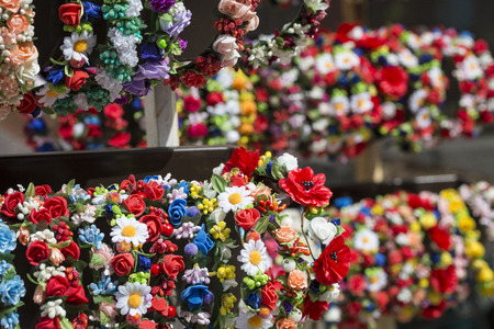 boxing day sale: Colorful traditional flower wreath on sale on local market.