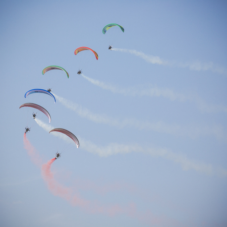 RADOM, POLAND - AUGUST 26, 2017 :The Flying Dragons aerobatic group of paramotor flying in the Air Show Radom 2017. Editorial