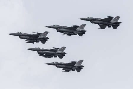 RADOM, POLAND - AUGUST 27, 2017 : Unidentified pilots from Polish Army present Lockheed Martin F-16 during Air Show Radom 2017