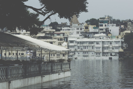 UDAIPUR, INDIA - SEPTEMBER 15, 2017: Lake Pichola with City Palace view in Udaipur, Rajasthan, India