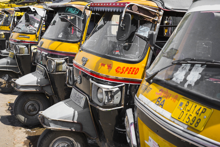 JAIPUR, INDIA -  SEPTEMBER 18, 2017: Auto rickshaws or tuk-tuk taxi on a street in the Jodhpur. Publikacyjne