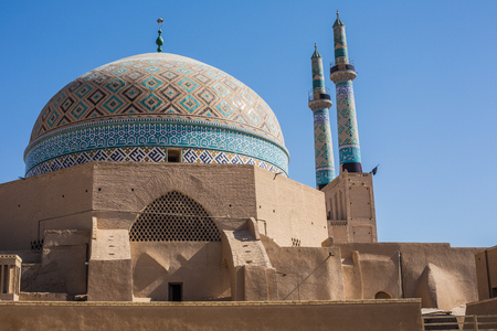 View over the Old City of Yazd, Iran and Masjed-i Jame mosque - famous for its wind towers.