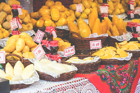 Traditional polish smoked cheese oscypek on christmas market in Cracow. Oscypek is made exclusively in Tatra Mountains region of Poland.