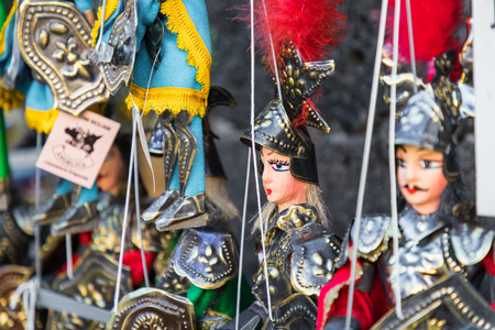 Some Sicilian puppets with their typical brassy armor and painted face