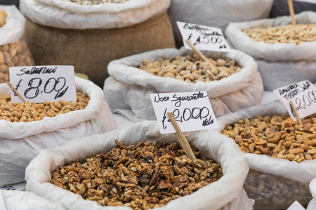 Many different colorful spices, nuts and dried fruits at market in Catania, Sicily, Italy. Stock Photo