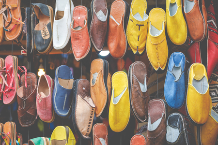 Moroccan leather goods bags and slippers at outdoor market in Marrakesh, Morocco. Stock Photo