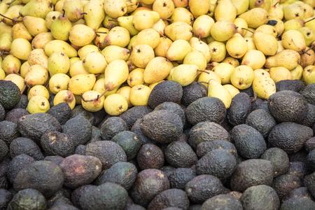 Big bunch of avocados at farmer market Stock Photo