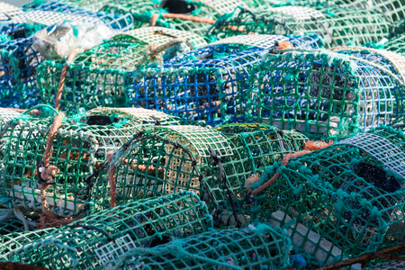 Crayfish cages on a fishing vessel Stock Photo