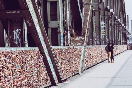 COLOGNE, GERMANY - FEBRUARY 19, 2018: Thousands of love locks which sweethearts lock to the Hohenzollern Bridge to symbolize their love on August 26 in Koln, Germany Editorial