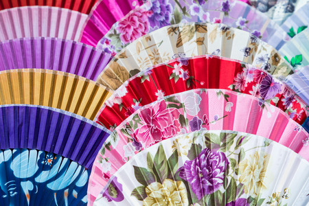 Traditional handicraft chinese fans at market in Yangshuo, China. Stock Photo