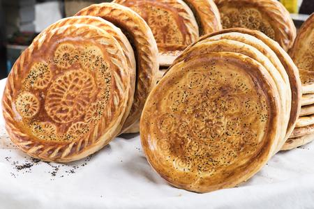 Traditional uzbekistan bread lavash at local bazaar, is a soft flat-bread of Middle Asia (Uzbekistan).