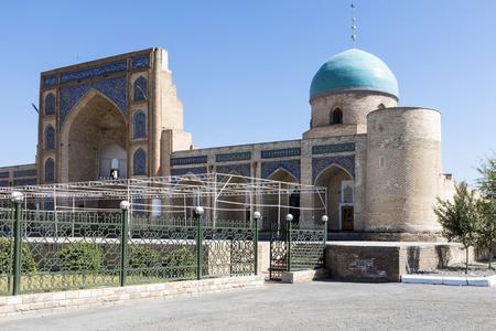 The facade of the Norbut-biy Madrasah in Kokand, Uzbekistan.