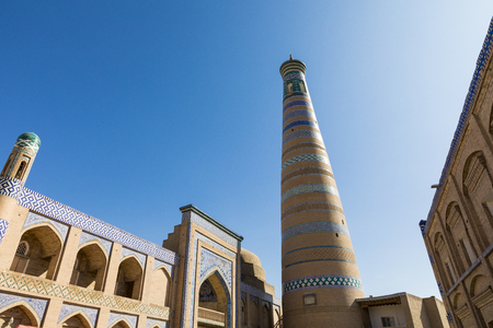 Historic buildings at Itchan Kala fortress in the historic center of Khiva. Uzbekistan, Central Asia
