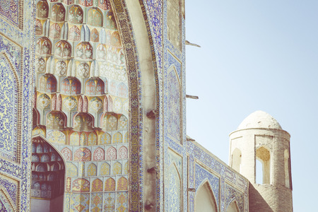 Decorative patterns and architectural details at the main entrance of Abdullaziz Khan madrasah in Bukhara, Uzbekistan