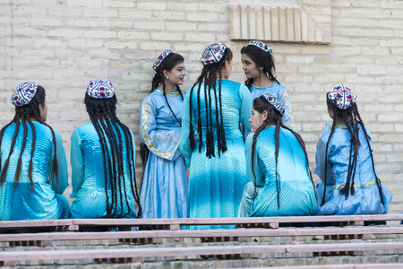 KHIVA, UZBEKISTAN - AUGUST 26, 2018: Folk dancers performs traditional dance at local festivals.