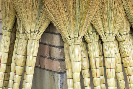 A pile of bamboo brooms in market for sale at Uzbekistan bazaar.
