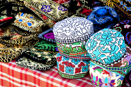 The traditional Uzbek cap named tubeteika, decorated with multi colored embroidery. Bukhara, Uzbekistan, Central Asia Stock Photo