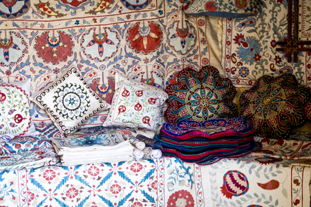 Market stalls with decorative tribal textile with colourful pattern made in Central Asia, Uzbekistan.