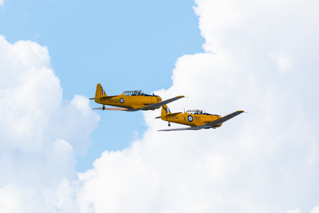 GIZYCKO, POLAND - AUGUST 5, 2018: North American T-6 Texan DUN from 1938 aircraft at Air Show Mazury 2018 event at the lake Niegocin in Gizycko. Poland.