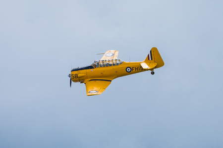 GIZYCKO, POLAND - AUGUST 5, 2018: North American T-6 Texan DUN from 1938 aircraft at Air Show Mazury 2018 event at the lake Niegocin in Gizycko. Poland. Editorial