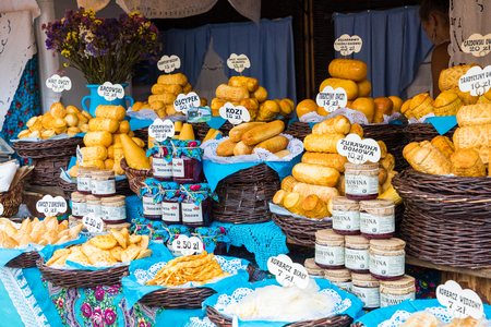CRAKOW, POLAND - AUGUST 16,2018: Traditional polish smoked cheese oscypek on christmas market in Cracow. Oscypek is made exclusively in Tatra Mountains region of Poland