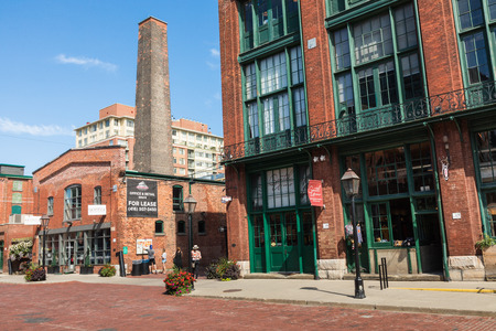 TORONTO, CANADA - SEPTEMBER 18, 2018: Distillery District (former Gooderham & Worts Distillery) - historic and entertainment precinct. It contains numerous cafes, restaurants, shops and industrial parts. Editorial