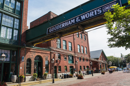 TORONTO, CANADA - SEPTEMBER 18, 2018: Distillery District (former Gooderham & Worts Distillery) - historic and entertainment precinct. It contains numerous cafes, restaurants, shops and industrial parts.
