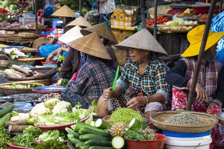 HUE, VIETNAM - NOVEMBER 19,2018: Sellers on the local market in Vietnam. Traditional food market in Hue, Vientam.