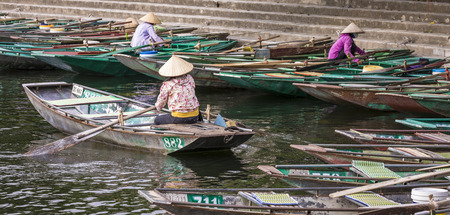 TAM COC, VIETNAM - NOVEMBER 15, 2018: Rowing boat waiting for passengers at Hoa Lu - Tam Coc, Ancient Town,Vietnam.