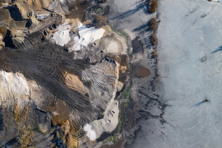 Aerial view of degraded landscape. Destroyed land. View from above. Industrial place. Photo captured with drone.