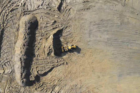 Aerial view of excavator and construction equipment. Machinery and mine equipment from above. Top view of industrial place. Photo captured with drone. Banco de Imagens